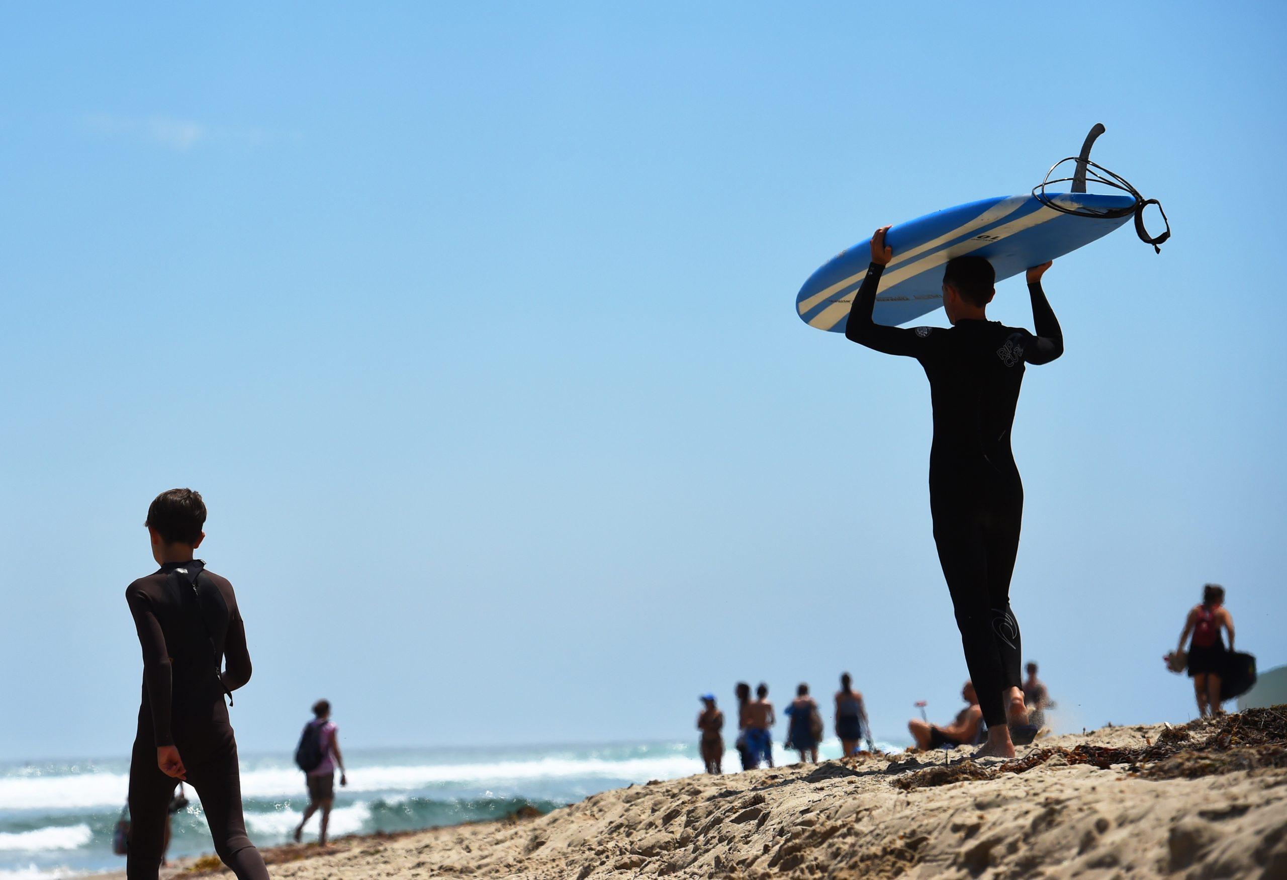 Surfers on shore at Malibu Surfrider Beach