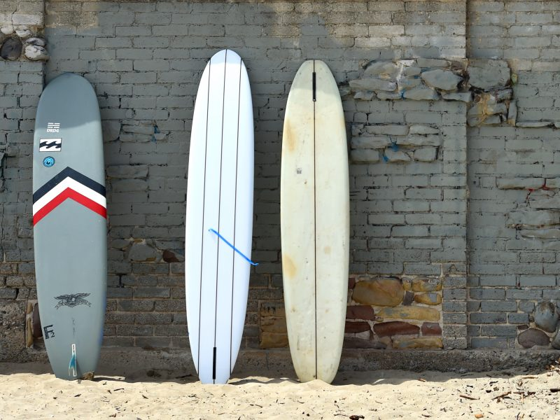 Surfboards against the historic wall at Malibu Surfrider Beach